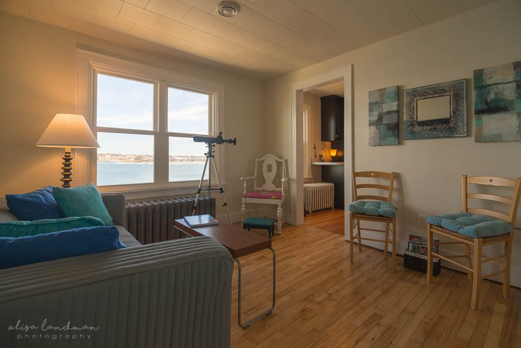 Living Room with telescope at Eagle's Nest, Waterfront Suite in Door County